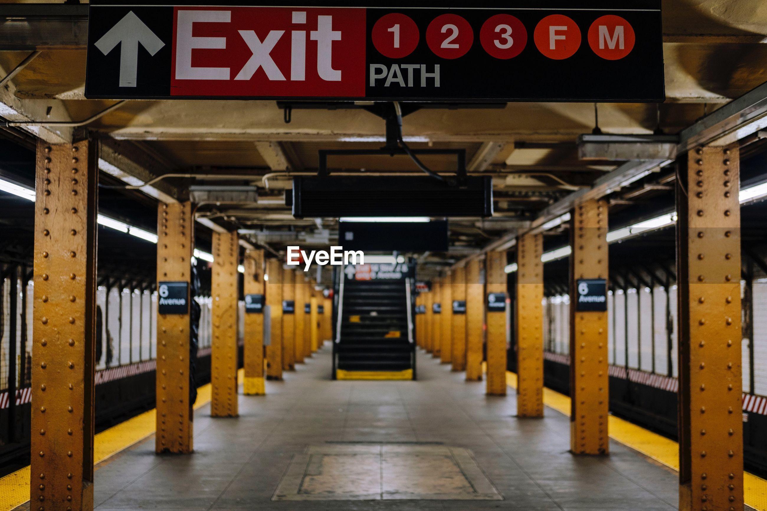 Exit sign on subway station platform