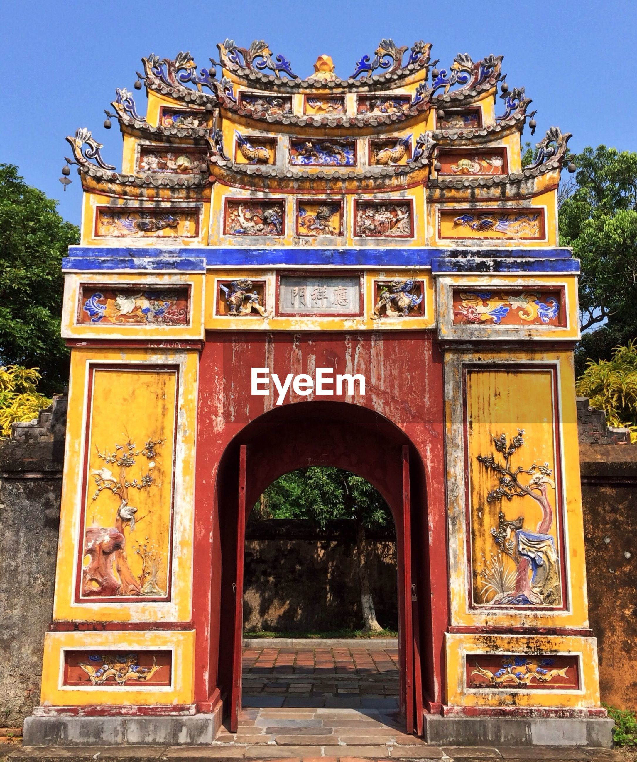 Exterior of temple entrance against clear sky