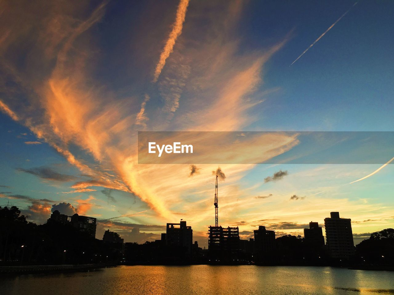sunset, architecture, building exterior, sky, built structure, city, skyscraper, water, waterfront, silhouette, river, cityscape, modern, no people, cloud - sky, travel destinations, outdoors, urban skyline