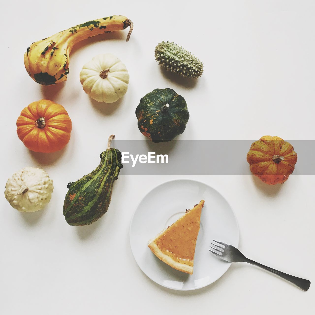 food, food and drink, freshness, healthy eating, white background, wellbeing, still life, studio shot, indoors, high angle view, no people, vegetable, eating utensil, pumpkin, group of objects, directly above, table, kitchen utensil, fruit, close-up