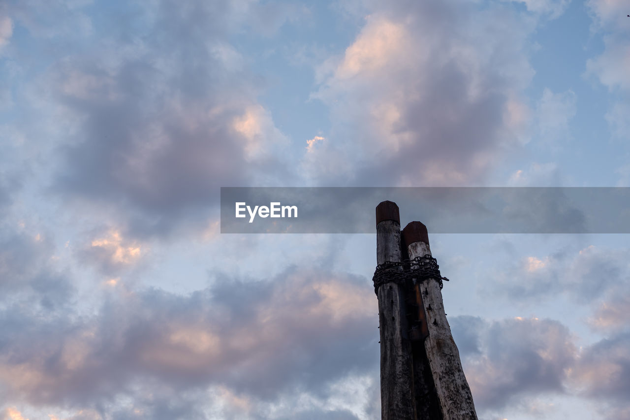 cloud - sky, sky, low angle view, nature, no people, architecture, built structure, outdoors, day, history, religion, the past, representation, tower, spirituality, sunset, art and craft, architectural column, old, building exterior