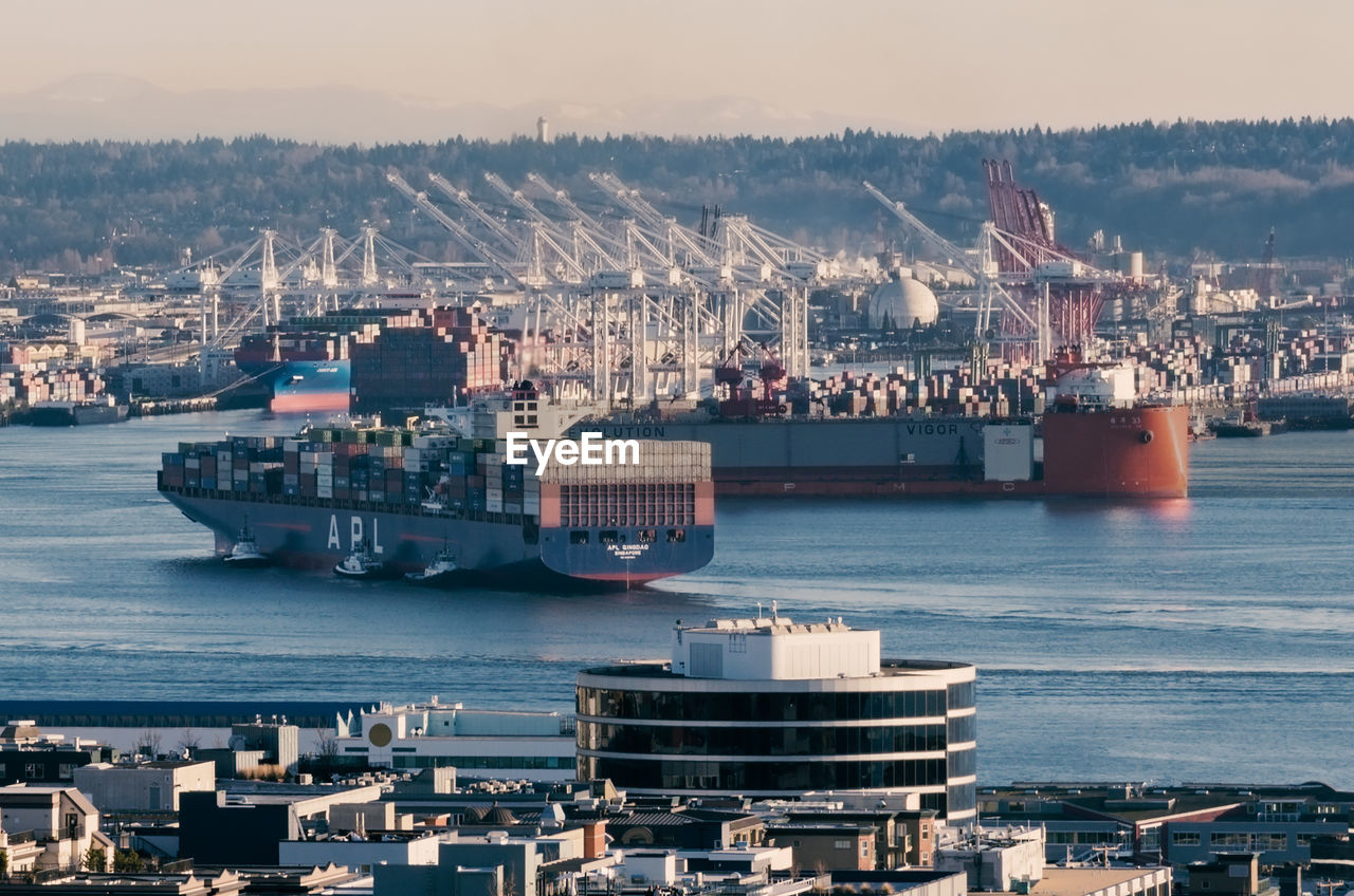 nautical vessel, transportation, mode of transportation, architecture, city, water, building exterior, freight transportation, sky, sea, commercial dock, ship, built structure, harbor, nature, business, shipping, container ship, pier, no people, cityscape, outdoors, cruise ship, port