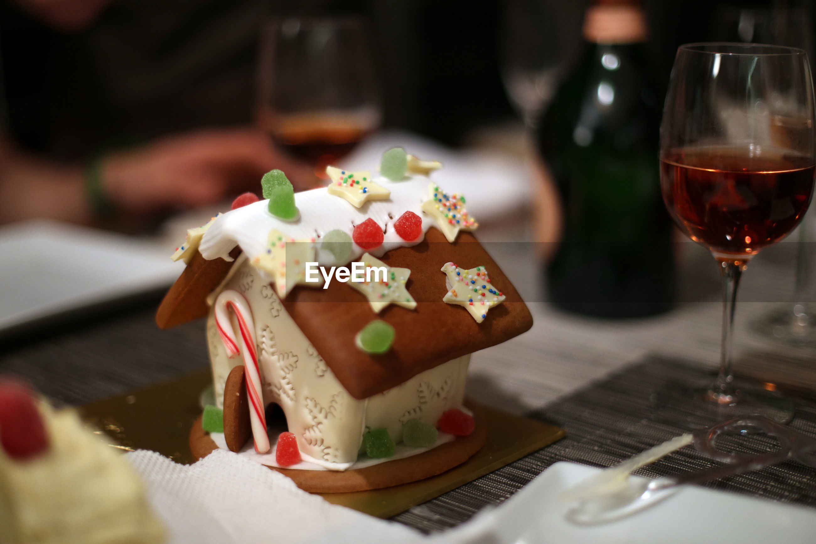 High angle view of house shape christmas cake on table