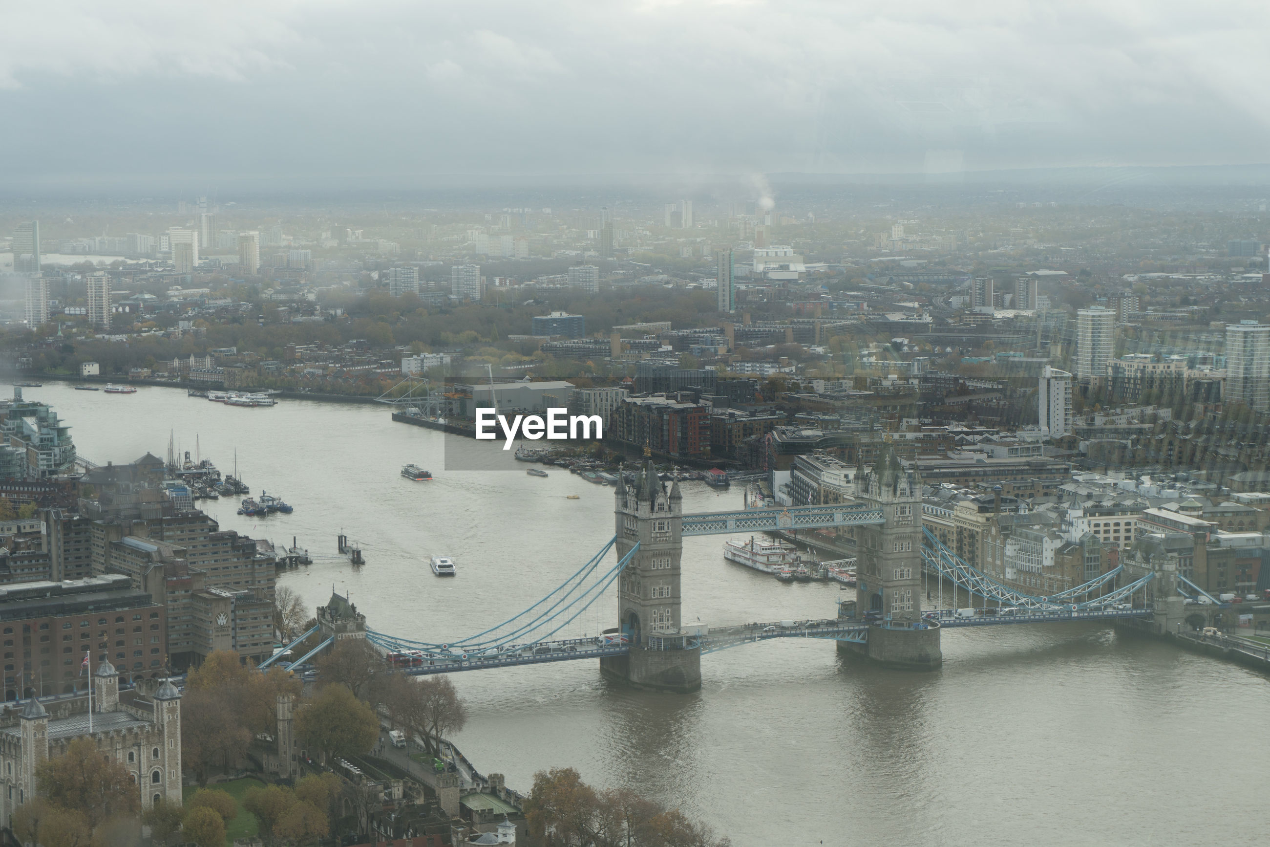 High angle view of river and buildings in city, london bridge