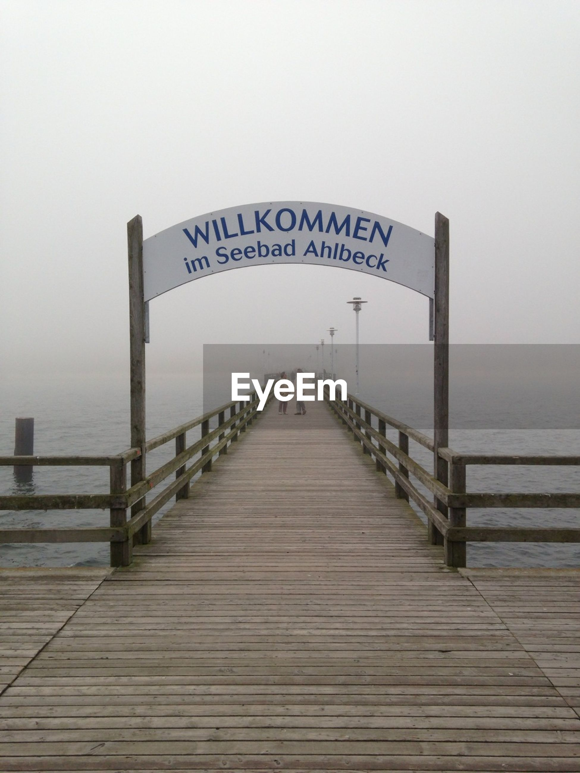 Welcome sign on ahlbeck pier during foggy weather