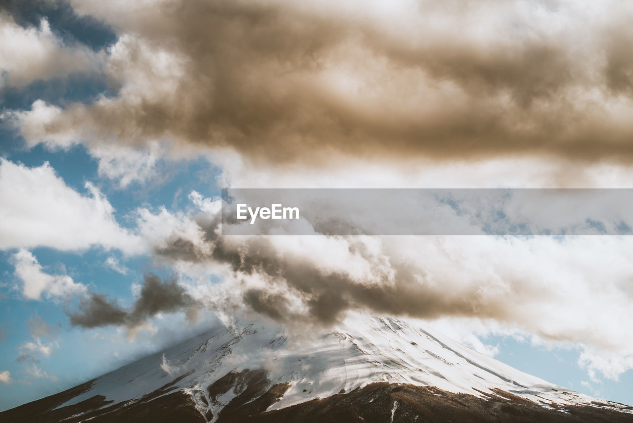 cloud - sky, sky, mountain, beauty in nature, scenics - nature, low angle view, cold temperature, nature, no people, tranquility, environment, tranquil scene, day, white color, non-urban scene, winter, snow, outdoors, mountain range, snowcapped mountain, mountain peak