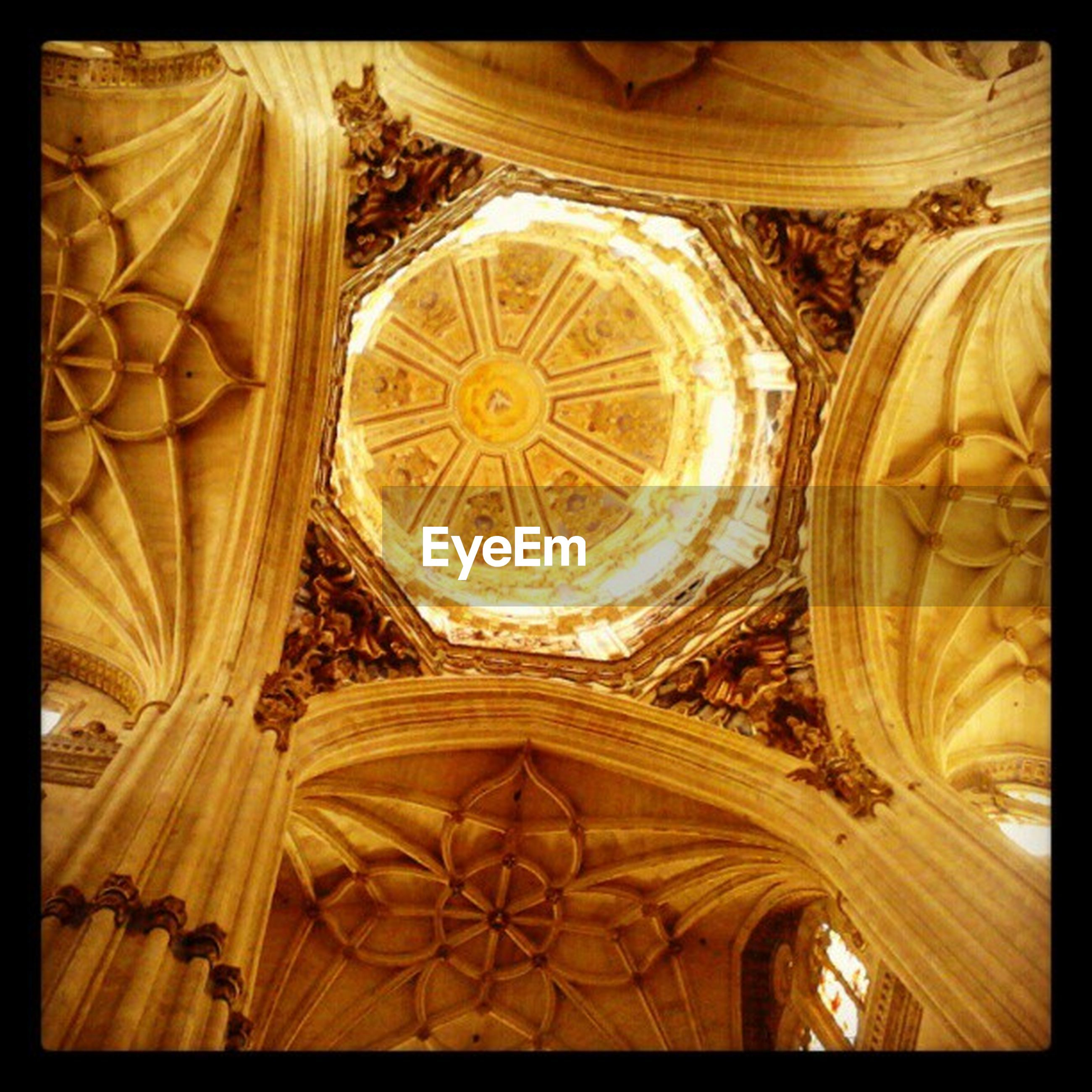 indoors, transfer print, religion, ceiling, ornate, place of worship, spirituality, design, pattern, church, art and craft, chandelier, auto post production filter, low angle view, art, creativity, architectural feature, decoration, interior