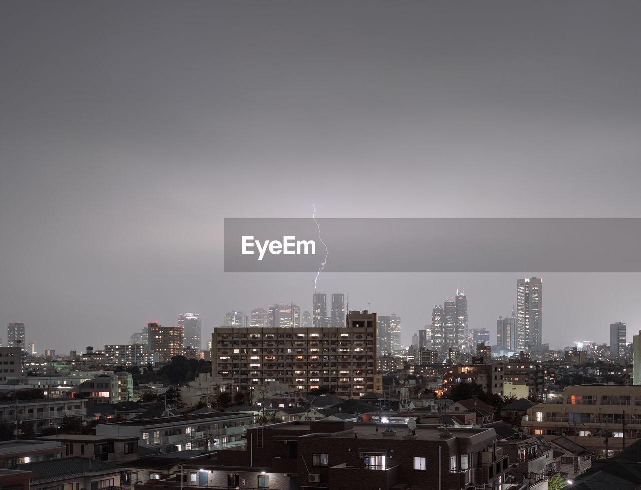 Lightning Over Cityscape At Night