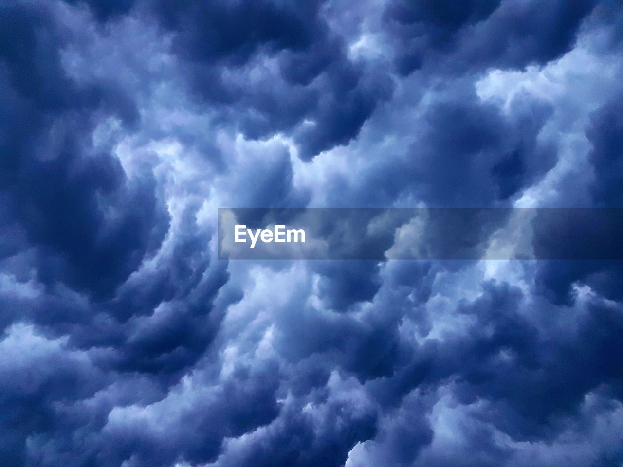cloud - sky, sky, beauty in nature, scenics - nature, low angle view, nature, no people, backgrounds, cloudscape, tranquility, day, storm, overcast, outdoors, dramatic sky, full frame, tranquil scene, blue, white color, meteorology