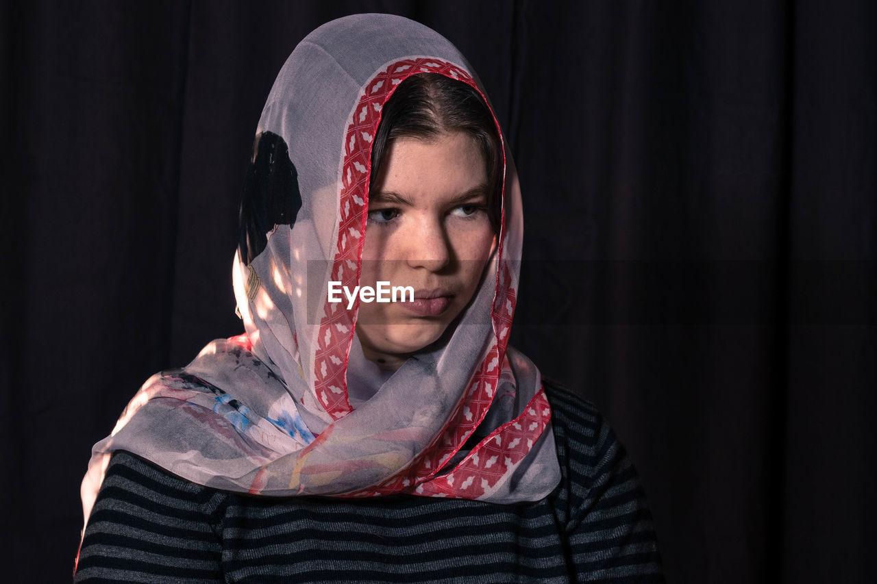 Portrait Of A Woman Wearing Headscarf