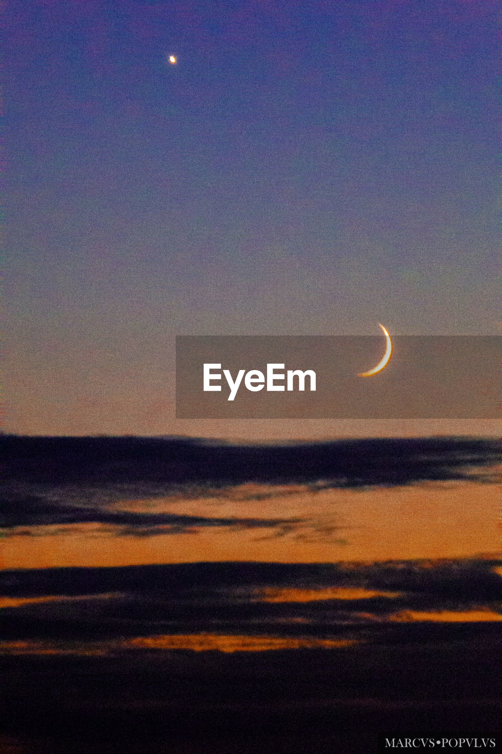 sky, scenics - nature, beauty in nature, moon, sunset, tranquil scene, cloud - sky, crescent, tranquility, nature, idyllic, night, astronomy, space, orange color, no people, outdoors, dusk, half moon, non-urban scene, planetary moon, eclipse