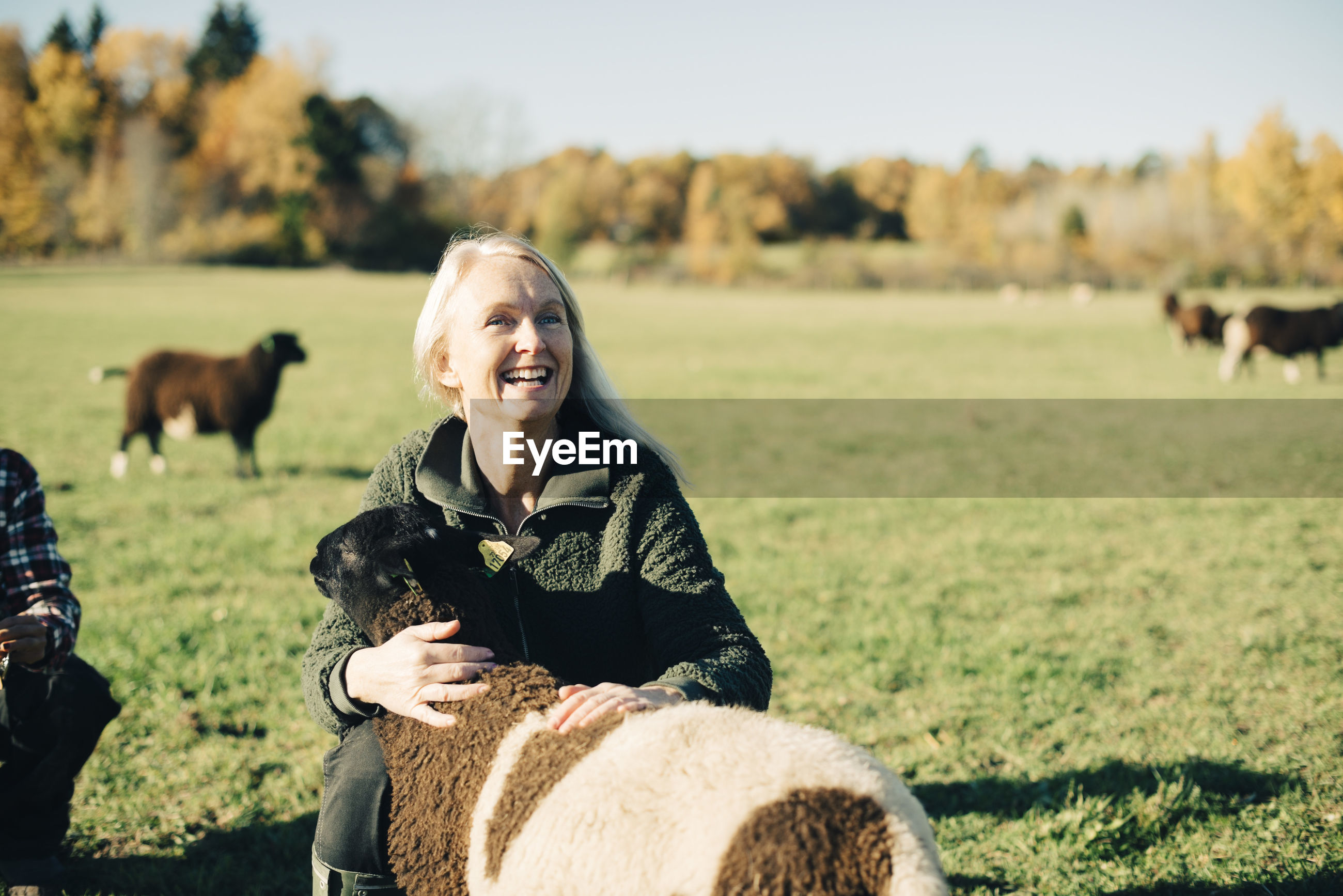 SMILING WOMAN ON FIELD