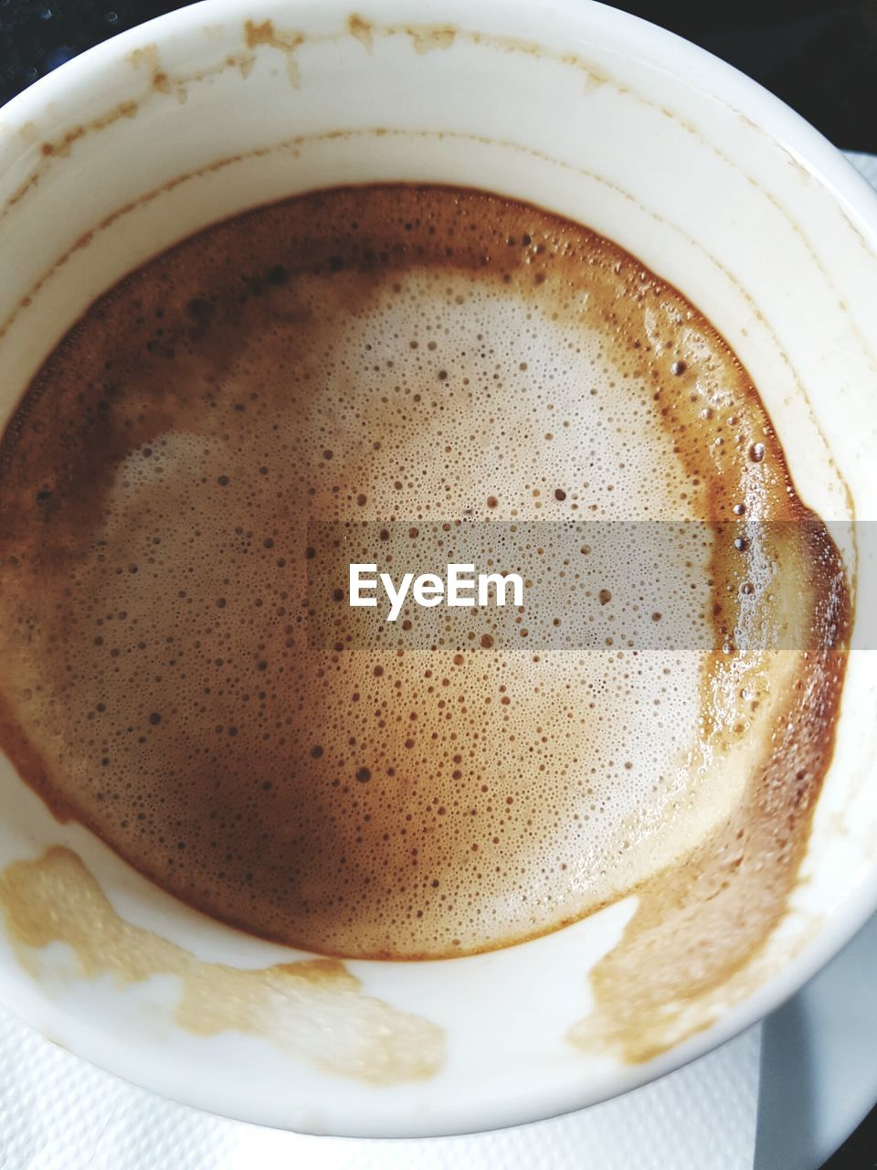 coffee cup, coffee - drink, food and drink, drink, frothy drink, refreshment, indoors, froth, still life, freshness, close-up, cappuccino, table, no people, saucer, high angle view, plate, froth art, food, mocha, day