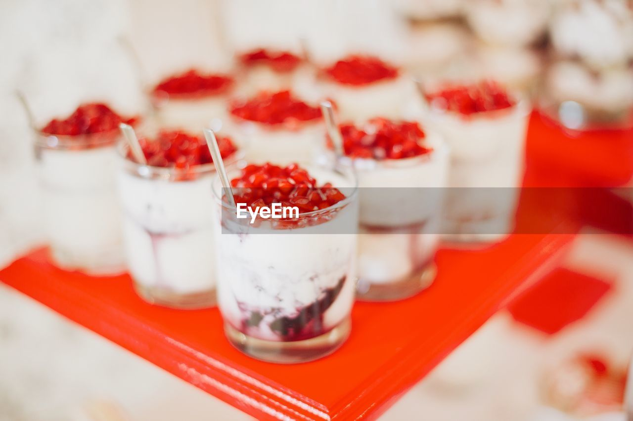 red, berry fruit, food and drink, fruit, food, freshness, healthy eating, strawberry, indulgence, close-up, dessert, yogurt, temptation, sweet food, still life, wellbeing, table, no people, sweet, raspberry, glass, snack