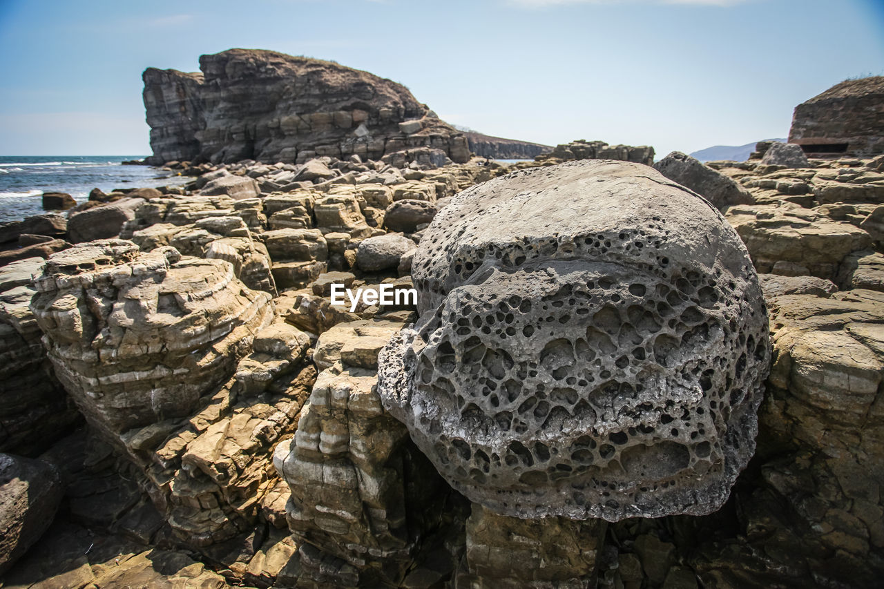 rock, rock - object, solid, sky, no people, rock formation, nature, tranquility, land, beauty in nature, day, sea, tranquil scene, textured, physical geography, rough, beach, sunlight, scenics - nature, geology, outdoors, eroded, stack rock