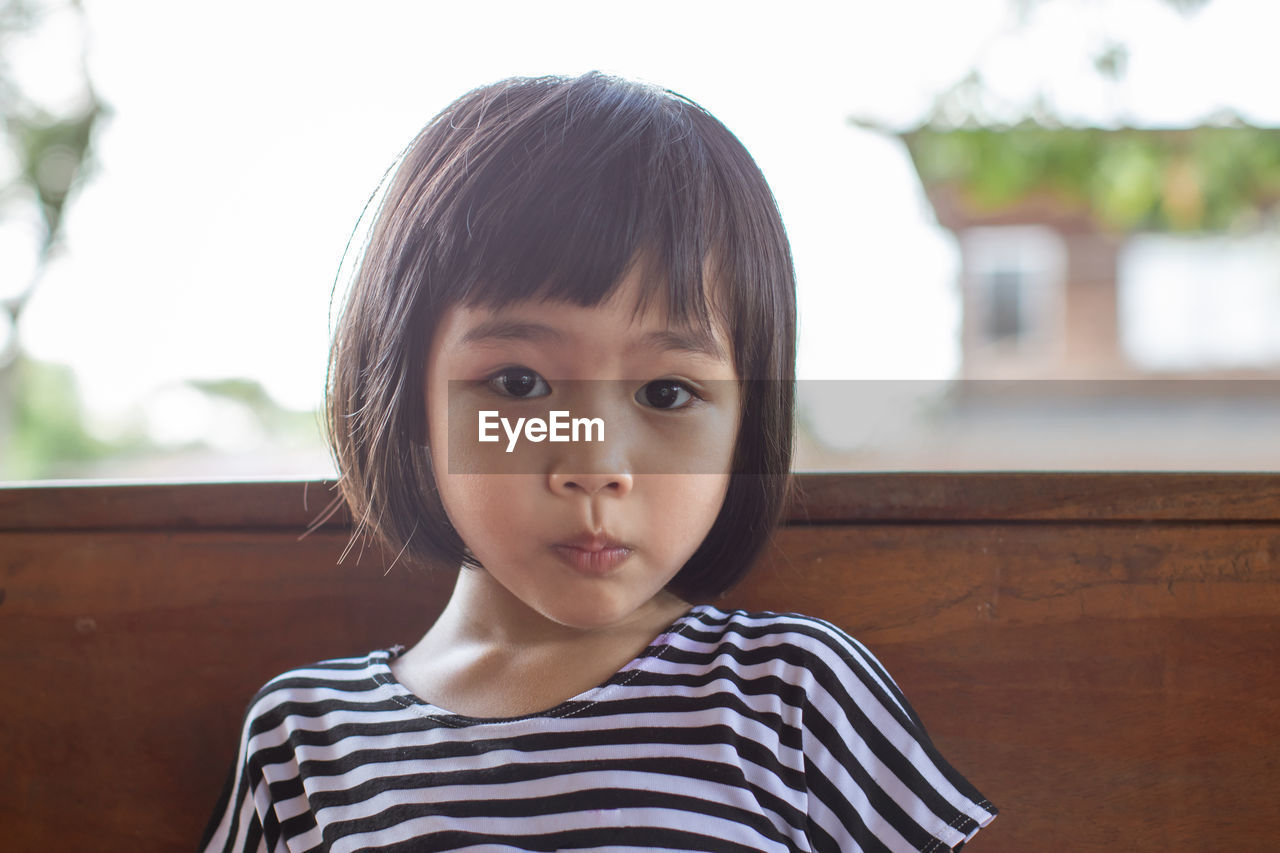 portrait, childhood, child, headshot, one person, front view, real people, focus on foreground, looking at camera, innocence, casual clothing, cute, striped, lifestyles, men, males, leisure activity, bangs, contemplation, human face