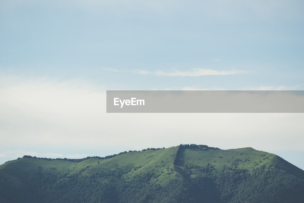 sky, beauty in nature, mountain, scenics - nature, tranquil scene, tranquility, cloud - sky, non-urban scene, nature, environment, no people, day, idyllic, landscape, outdoors, remote, mountain range, green color, plant, land, mountain peak