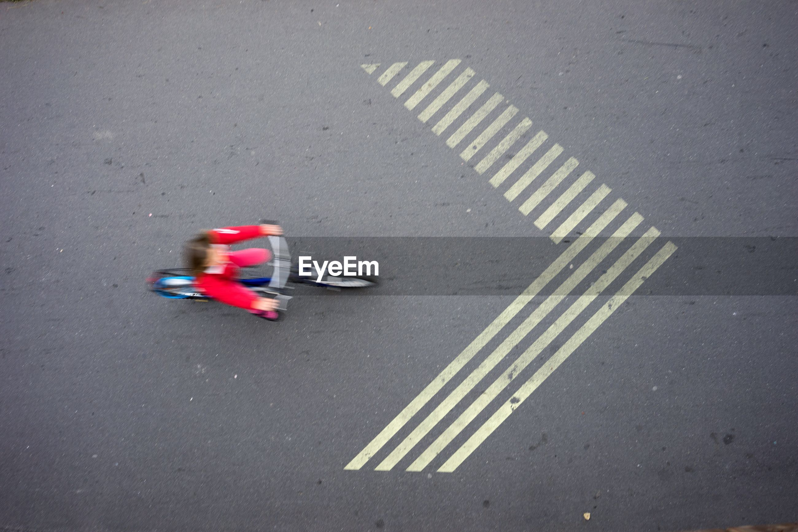 High angle view of person riding bicycle on road