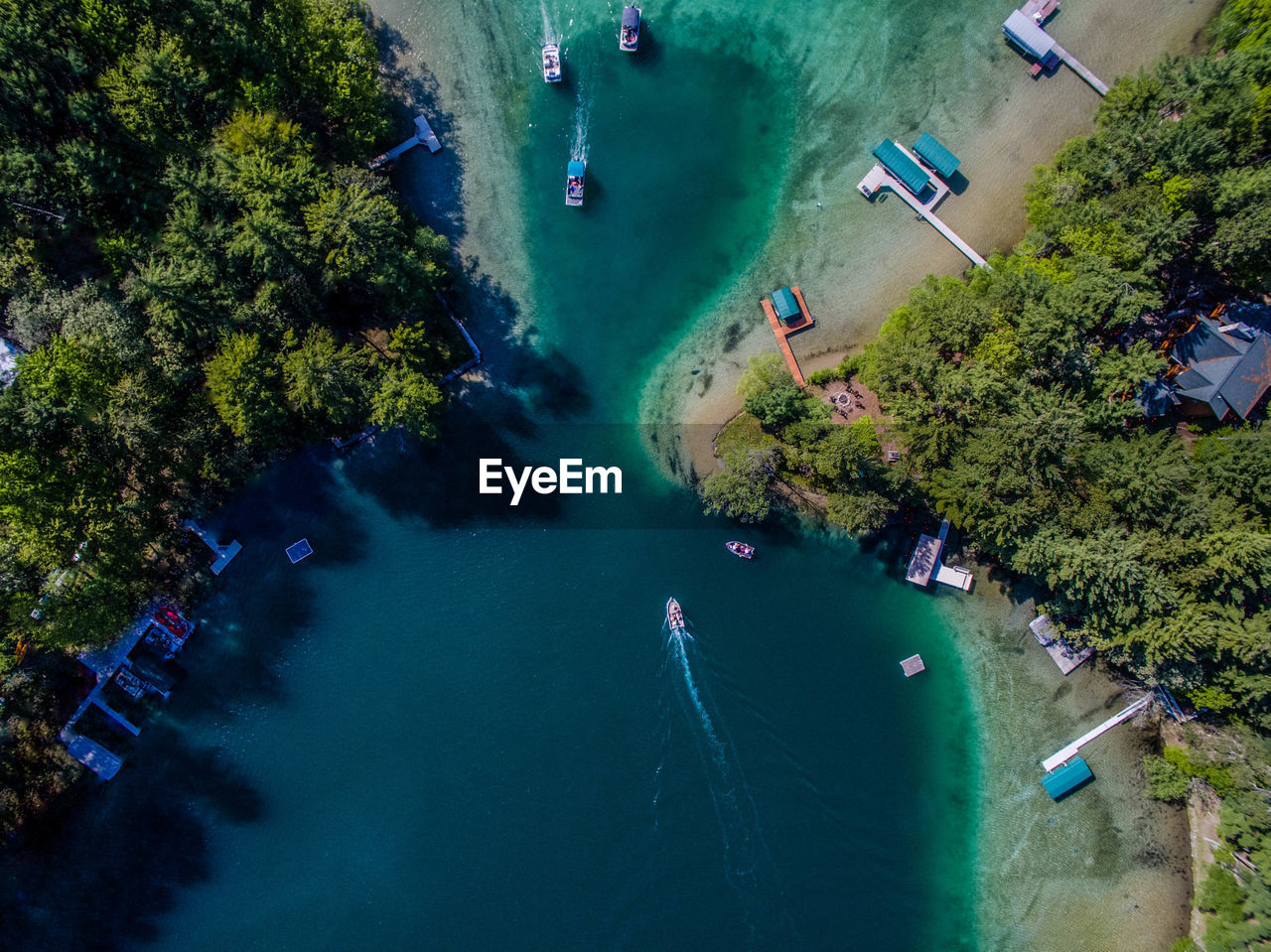 Aerial view of boats sailing in river