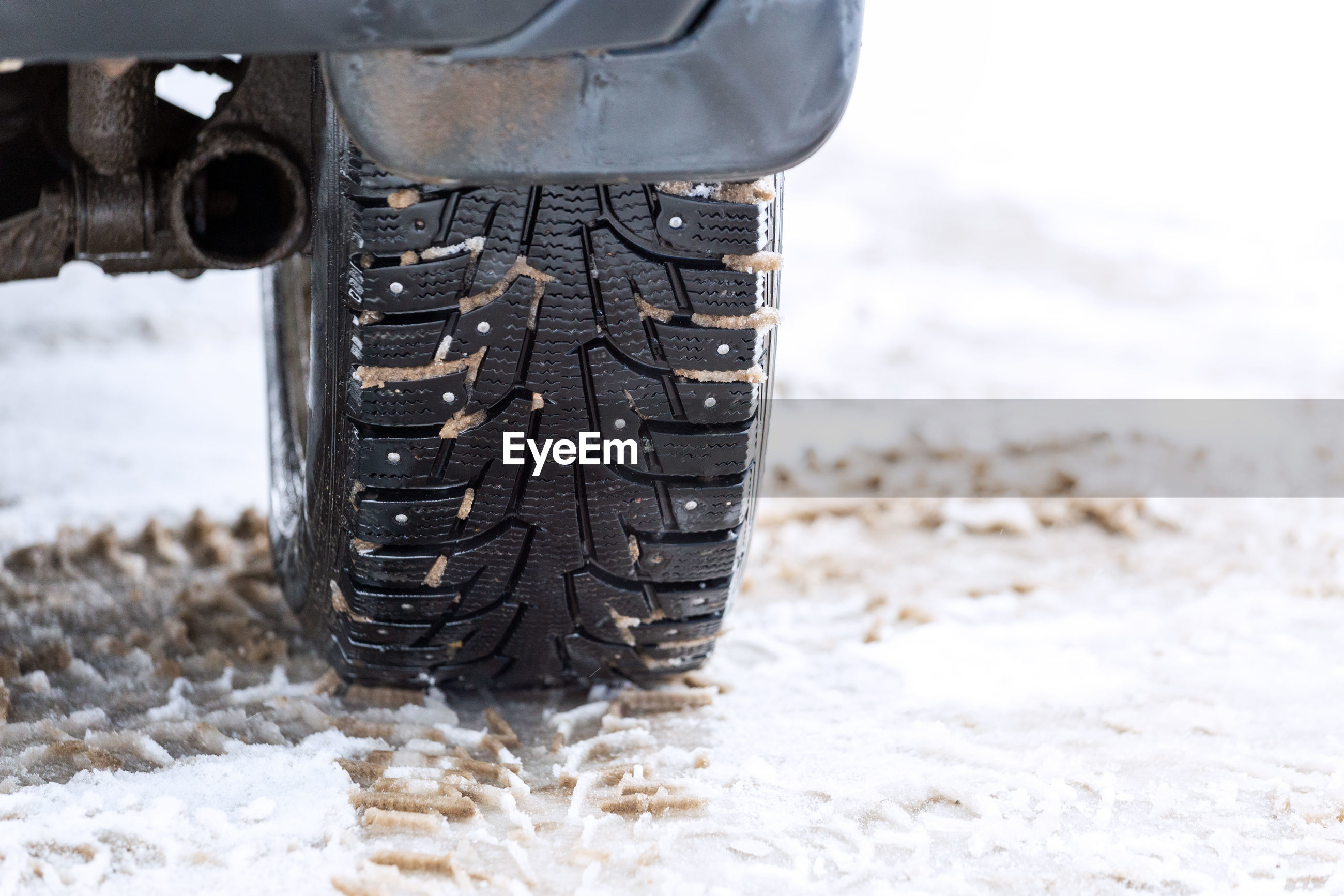CLOSE-UP OF TIRE TRACK IN SNOW