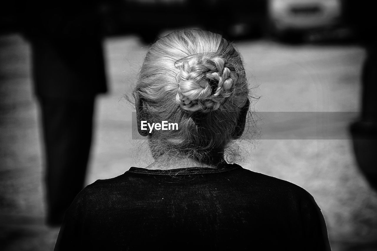 Rear View Of A Old Woman