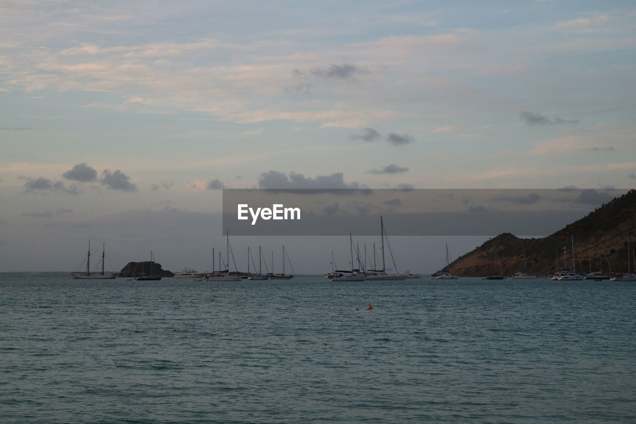 sea, nautical vessel, water, sky, sailboat, transportation, cloud - sky, mode of transportation, beauty in nature, waterfront, nature, scenics - nature, sailing, no people, mast, pole, sunset, outdoors, tranquil scene, yacht
