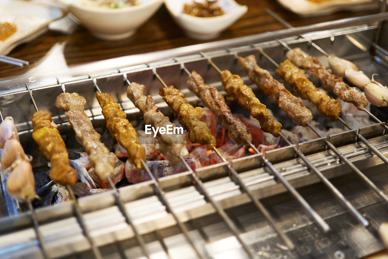 Close-Up Of Meat Skewers On Barbecue Grill
