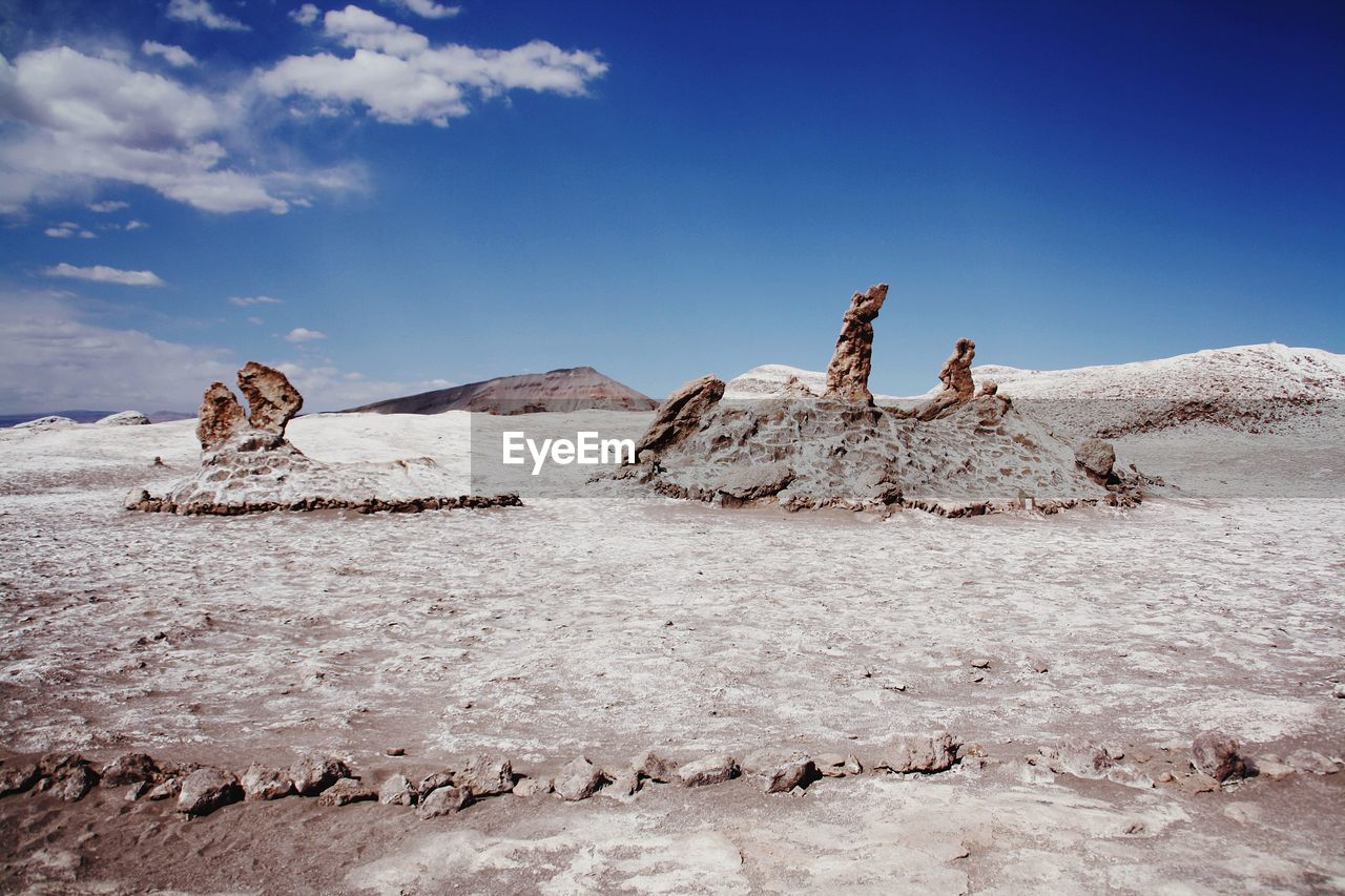 sky, scenics - nature, cloud - sky, nature, day, rock, beauty in nature, land, rock - object, tranquil scene, tranquility, real people, solid, rock formation, non-urban scene, environment, blue, landscape, desert, leisure activity, climate, outdoors, arid climate, salt flat