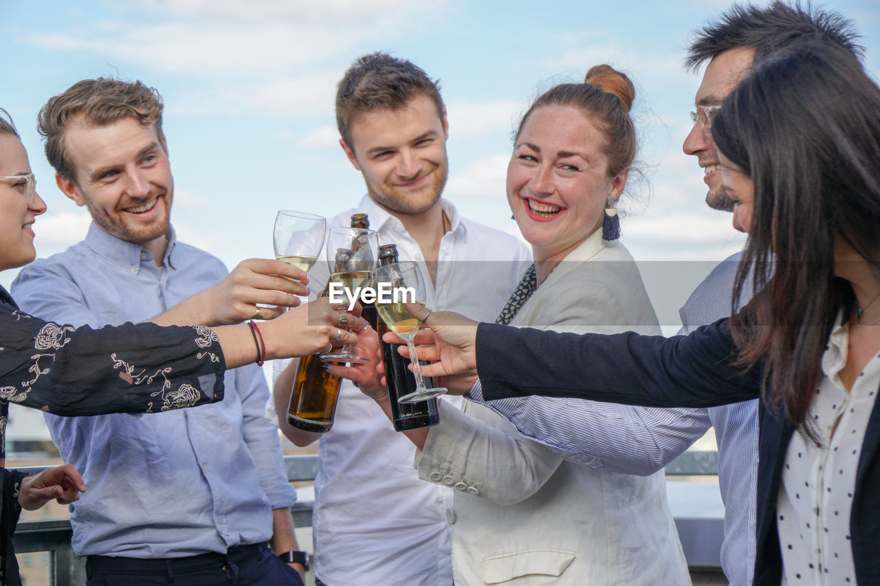 Group Of People Celebrating At Bar