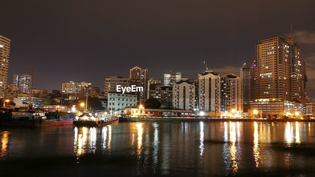 night, building exterior, architecture, illuminated, built structure, city, water, waterfront, skyscraper, reflection, cityscape, no people, nautical vessel, travel destinations, river, outdoors, sky, clear sky, urban skyline