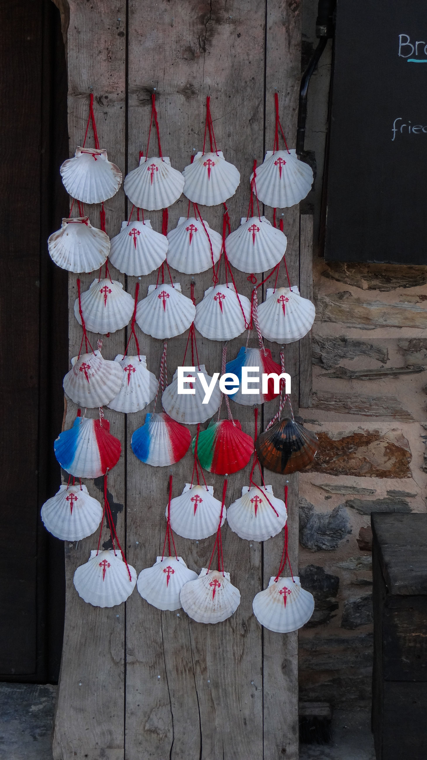 Clothes hanging in row at temple