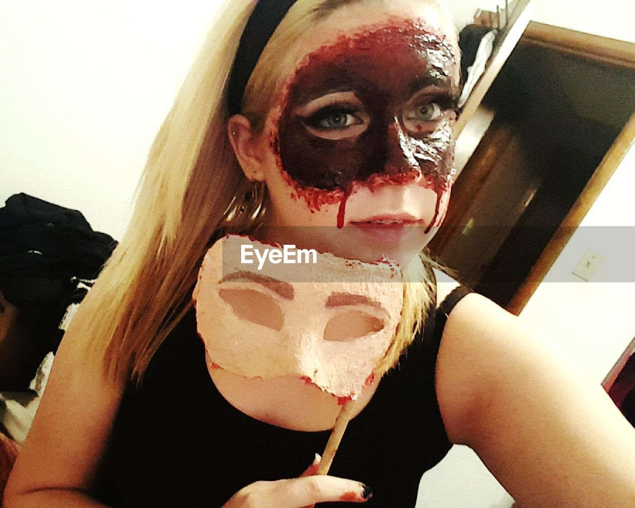 real people, halloween, one person, looking at camera, costume, leisure activity, horror, spooky, face paint, make-up, lifestyles, portrait, indoors, young adult, young women, white background, close-up, clown, day, people