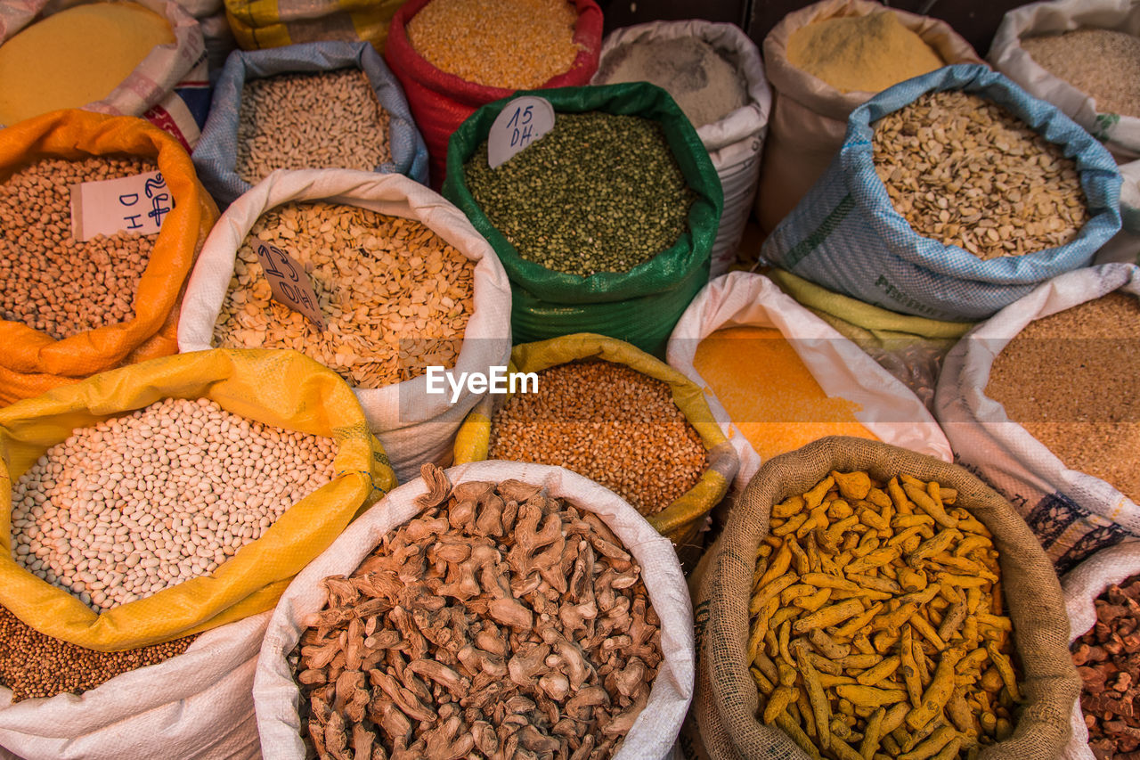 variation, choice, food and drink, food, market, sack, large group of objects, healthy eating, freshness, no people, dried food, retail, wellbeing, spice, multi colored, container, bag, high angle view, market stall, bean, retail display