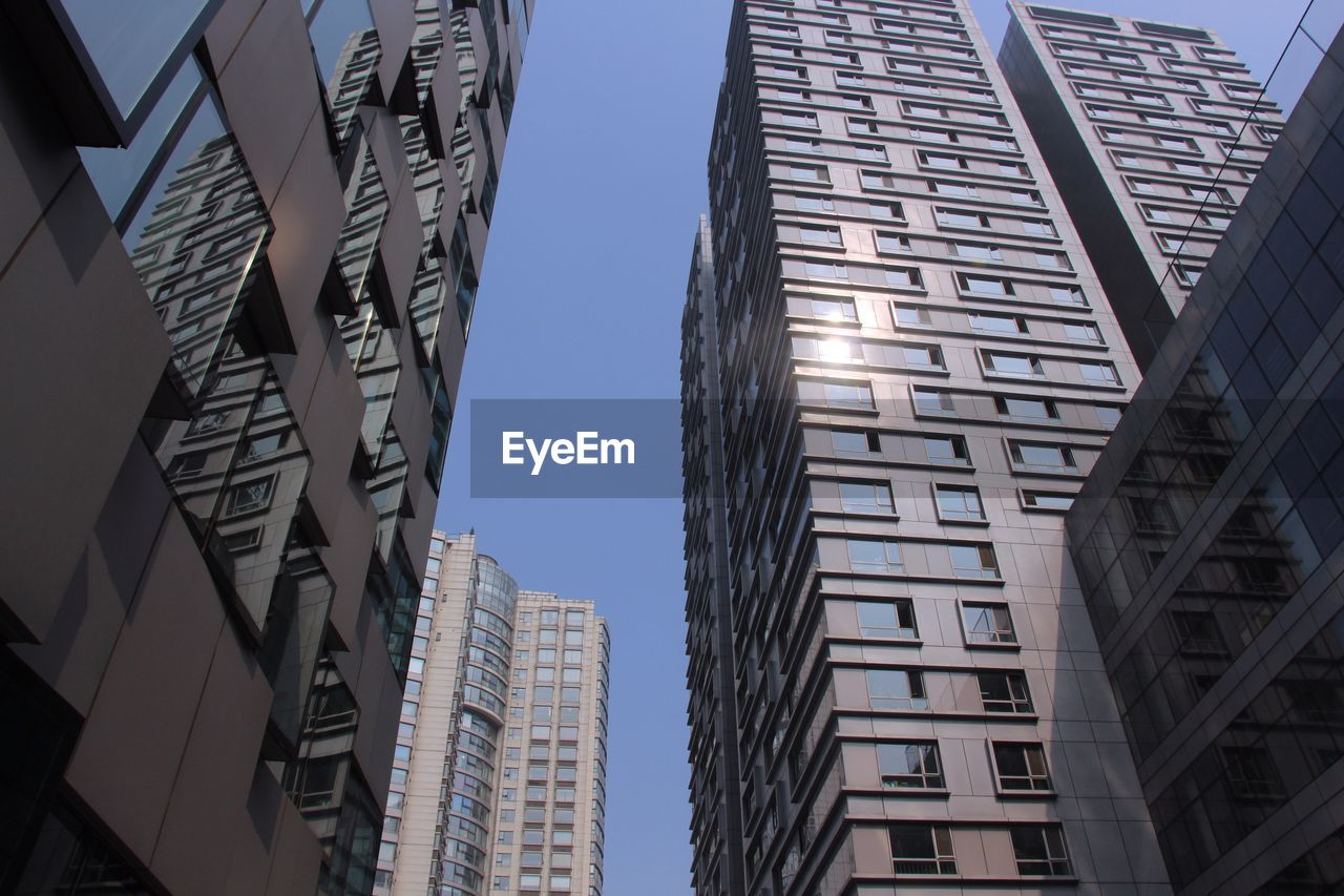 building exterior, architecture, low angle view, skyscraper, built structure, modern, day, city, clear sky, outdoors, no people, tall, sky