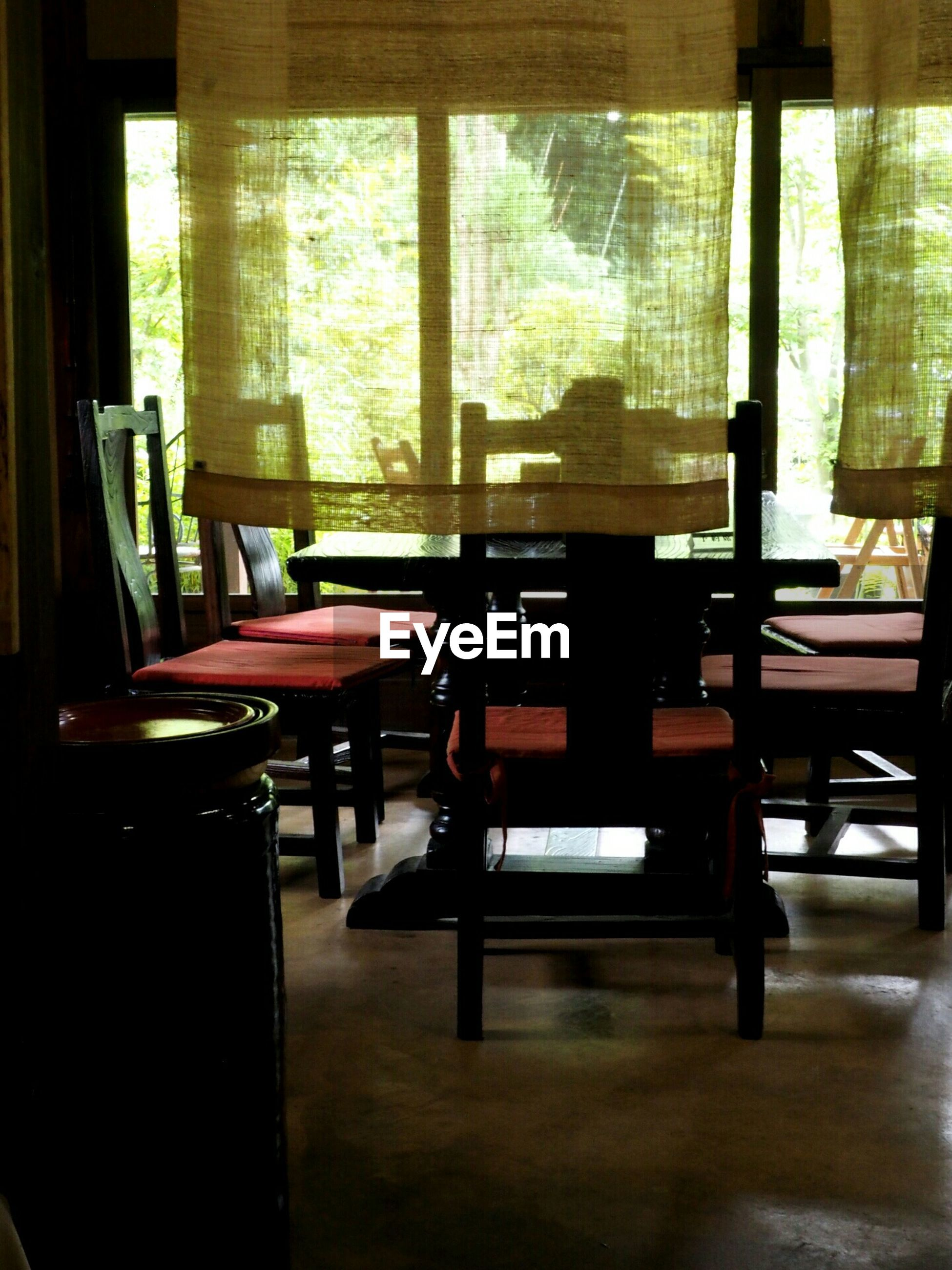 indoors, chair, table, absence, empty, window, home interior, restaurant, furniture, curtain, domestic room, living room, dining table, sitting, sofa, glass - material, home showcase interior, relaxation, domestic life, seat