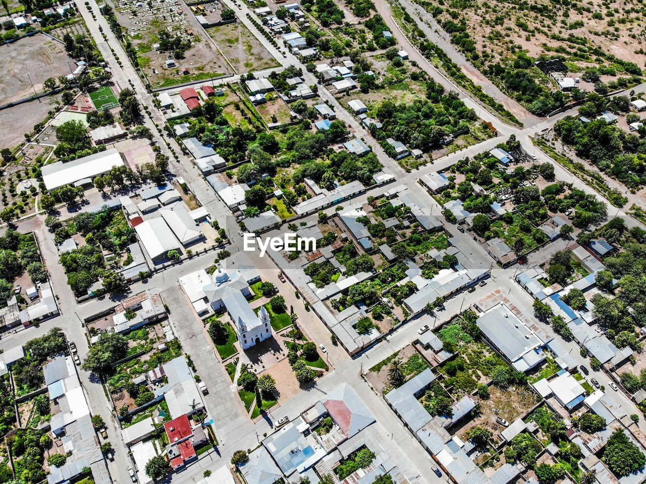 high angle view, built structure, architecture, aerial view, building exterior, city, plant, day, building, tree, nature, no people, full frame, transportation, outdoors, road, residential district, street, growth, environment, cityscape
