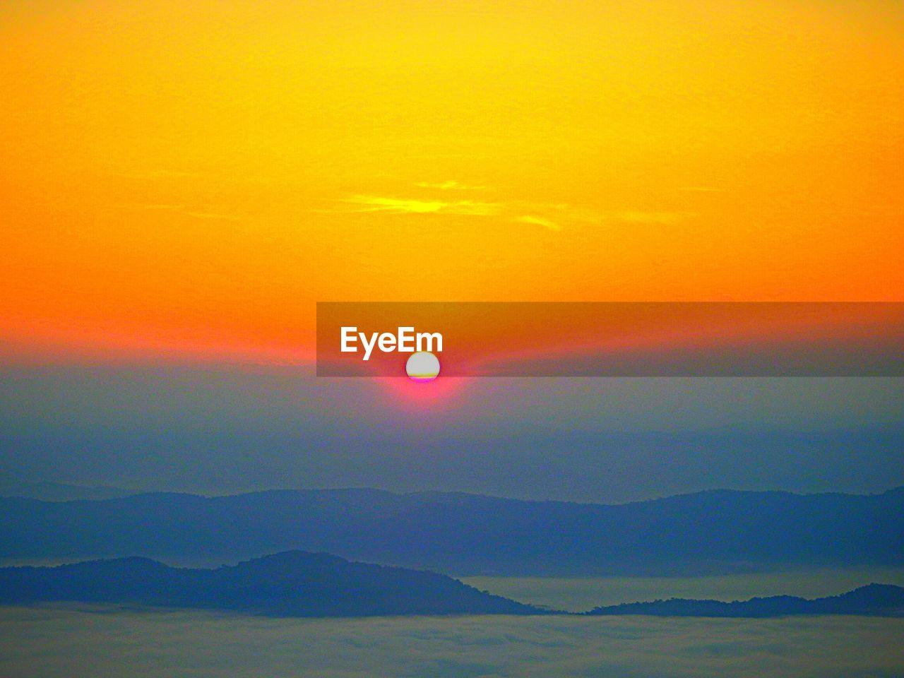 sky, beauty in nature, scenics - nature, sunset, sun, tranquil scene, tranquility, idyllic, environment, orange color, nature, cloud - sky, no people, dramatic sky, sunlight, mountain range, mountain, outdoors, sea, romantic sky