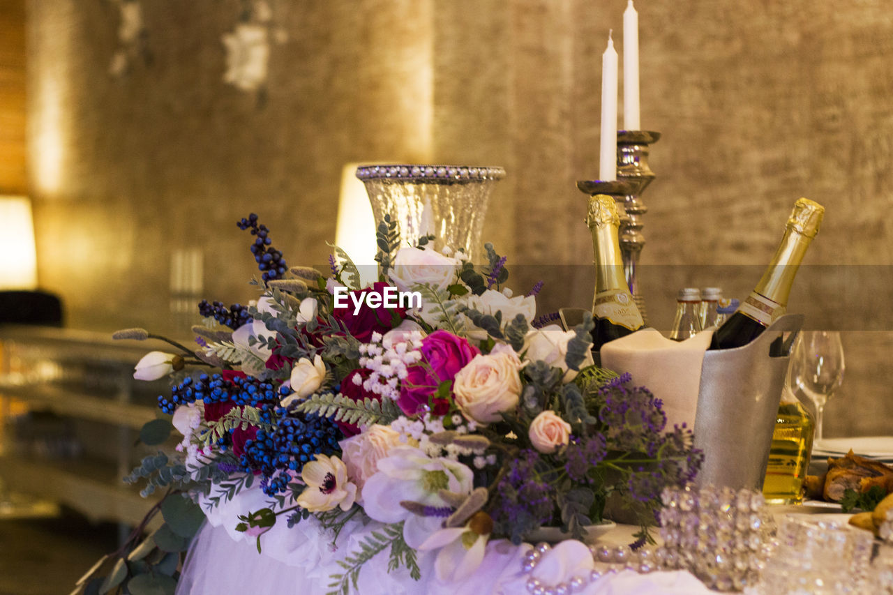 Flower vase on table, wadding and birthday desing