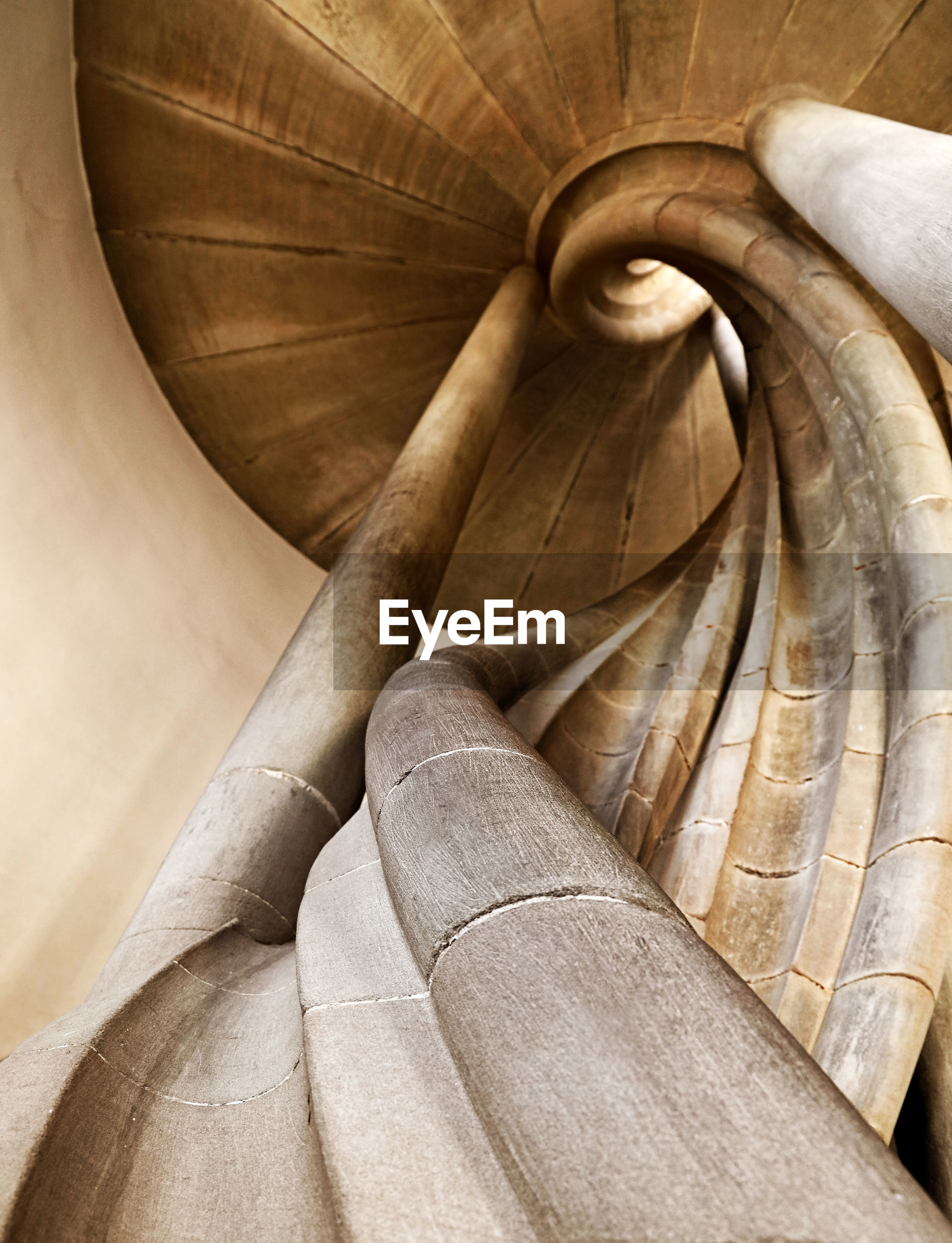 Low angle view of stone spiral staircase