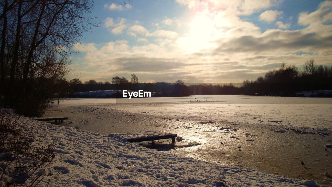 winter, snow, cold temperature, weather, sky, nature, no people, tranquil scene, cloud - sky, outdoors, tranquility, beauty in nature, scenics, sunset, landscape, sand, day, tree, water, bleak