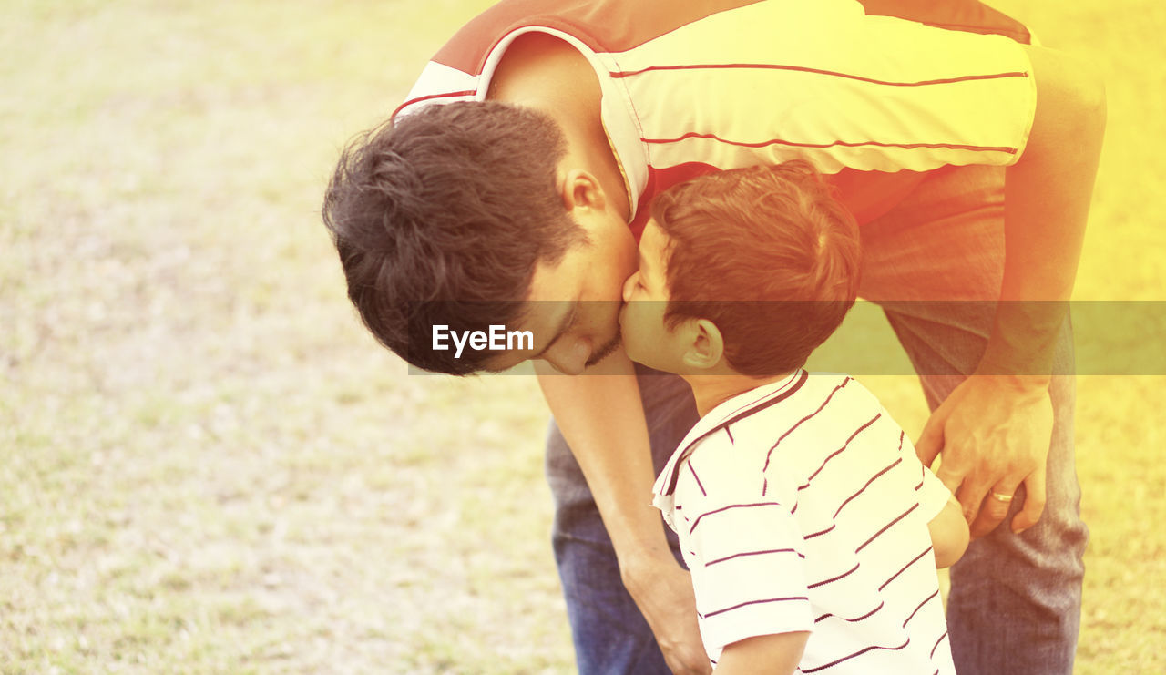 love, togetherness, positive emotion, males, emotion, bonding, casual clothing, men, two people, real people, childhood, boys, focus on foreground, child, leisure activity, lifestyles, nature, embracing, women, people, son, innocence, outdoors