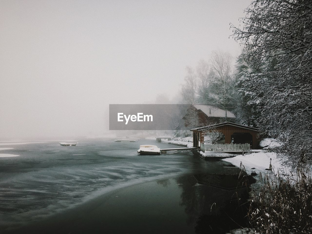 water, nature, fog, no people, built structure, sea, outdoors, tranquility, scenics, beauty in nature, day, architecture, cold temperature, winter, building exterior, tree, sky