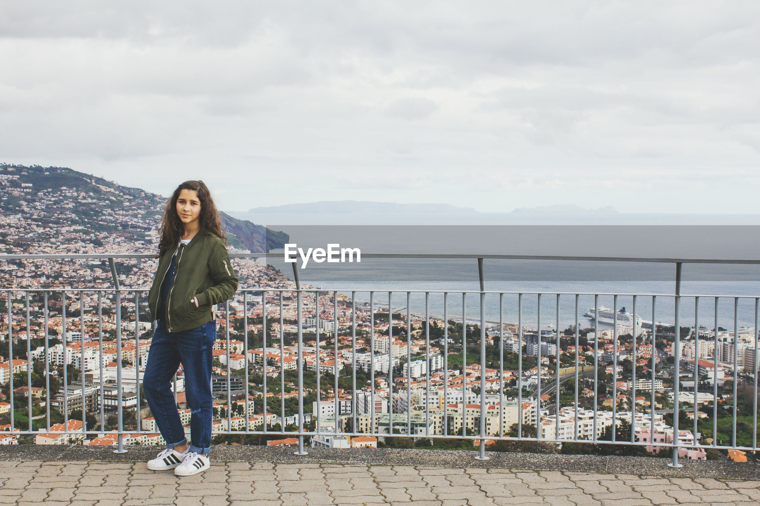 one woman only, one person, sky, outdoors, standing, day, portrait, cloud - sky, full length, only women, city, one young woman only, water, young adult, adults only, cityscape, people, adult
