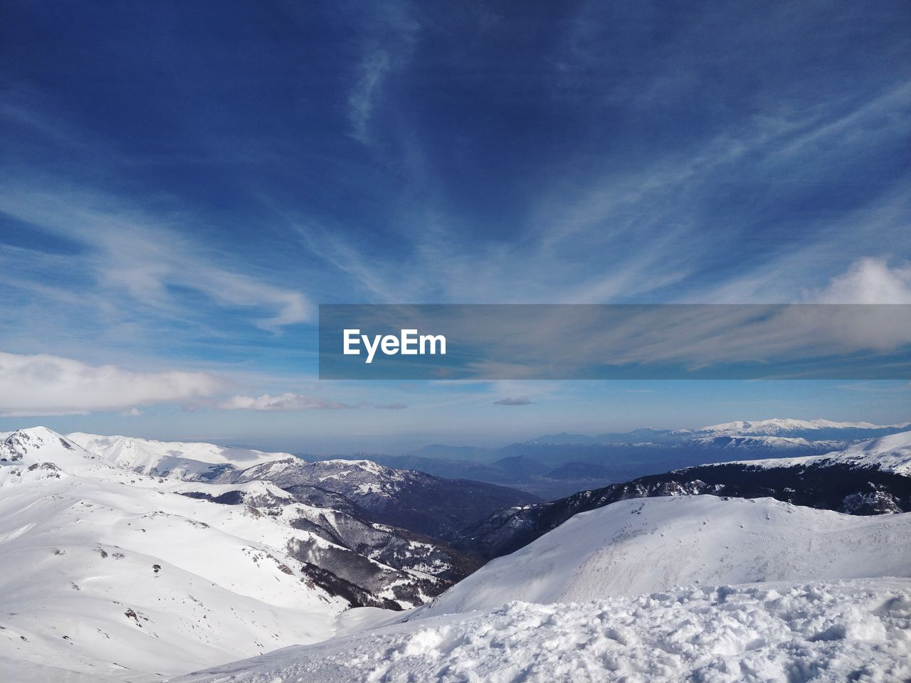 snow, cold temperature, winter, nature, beauty in nature, tranquil scene, scenics, tranquility, weather, snowcapped mountain, mountain, sky, landscape, cloud - sky, white color, blue, outdoors, no people, day, frozen, mountain range, sunlight