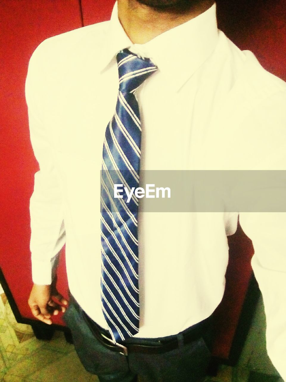 necktie, well-dressed, one person, men, formalwear, button down shirt, shirt and tie, menswear, real people, suit, fashion, midsection, standing, one man only, indoors, studio shot, businessman, collar, close-up, day, young adult, people