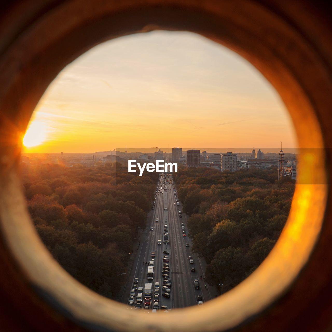 PANORAMIC VIEW OF CITY SEEN THROUGH WINDOW