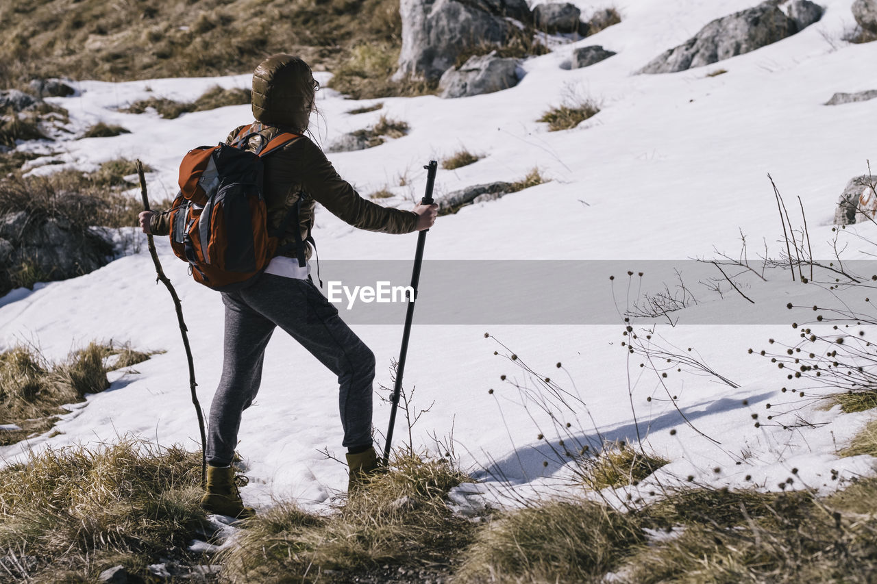 Full Length Of Woman On Snow Covered Mountain