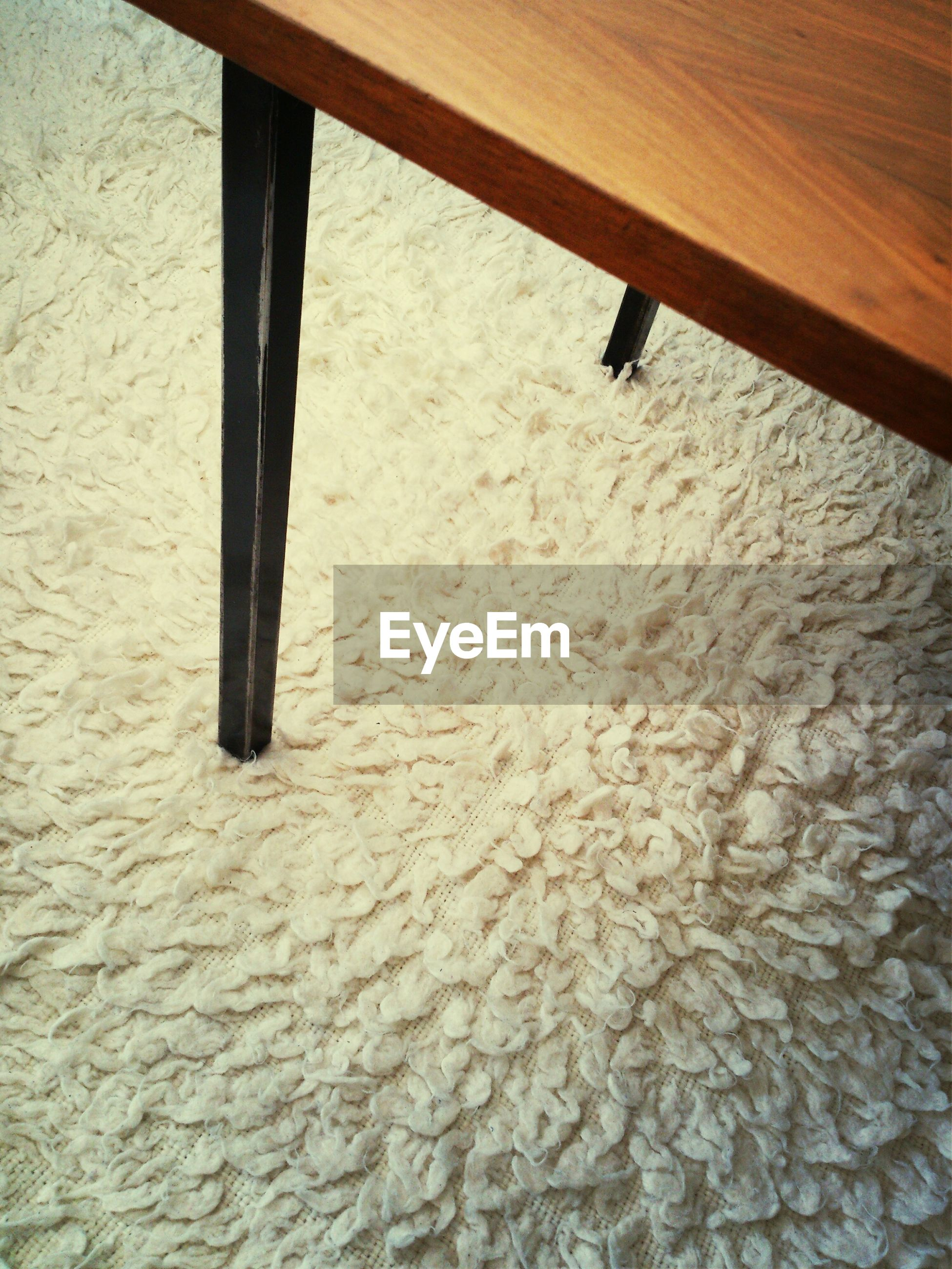 High angle view of table on carpet at home