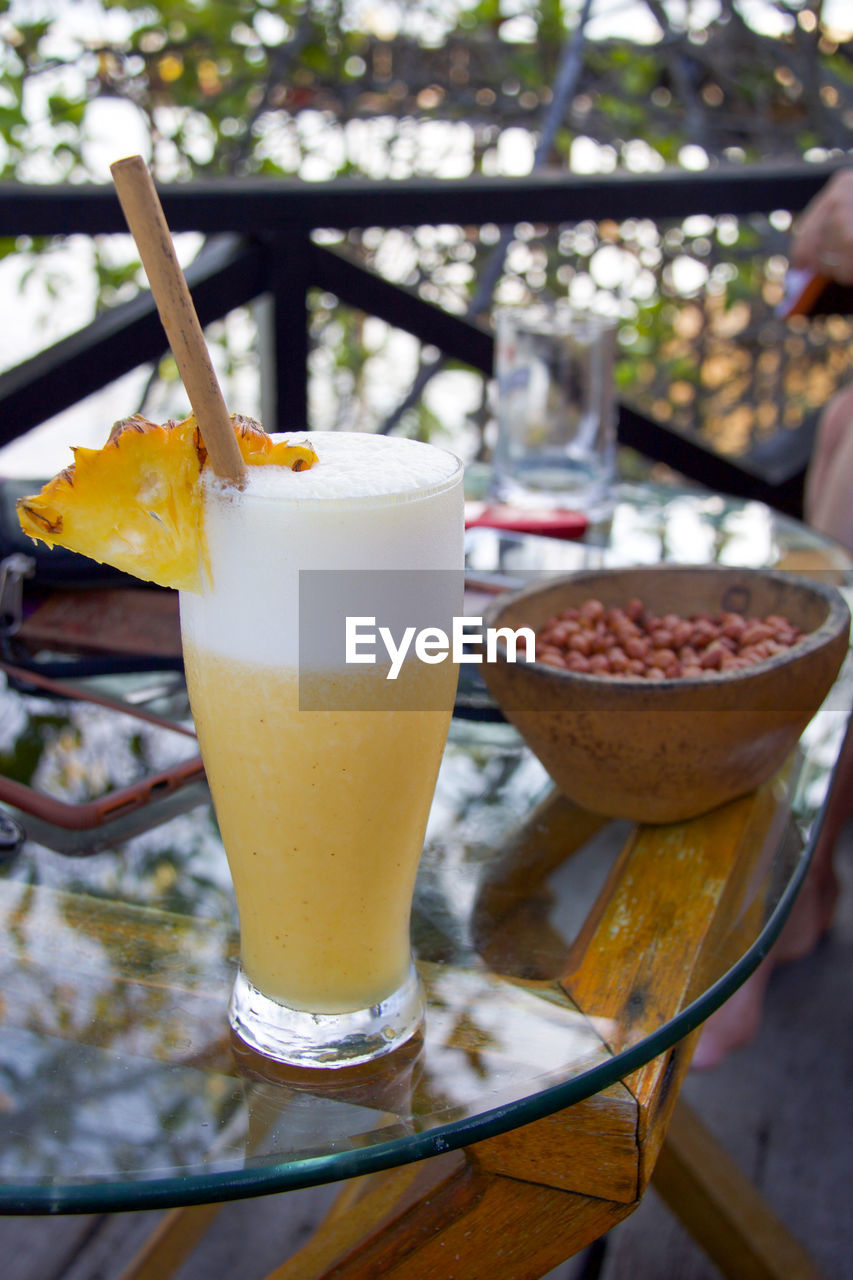 food and drink, refreshment, glass, drink, household equipment, food, drinking glass, table, freshness, focus on foreground, straw, close-up, drinking straw, wellbeing, healthy eating, alcohol, ready-to-eat, no people, coffee, day, temptation