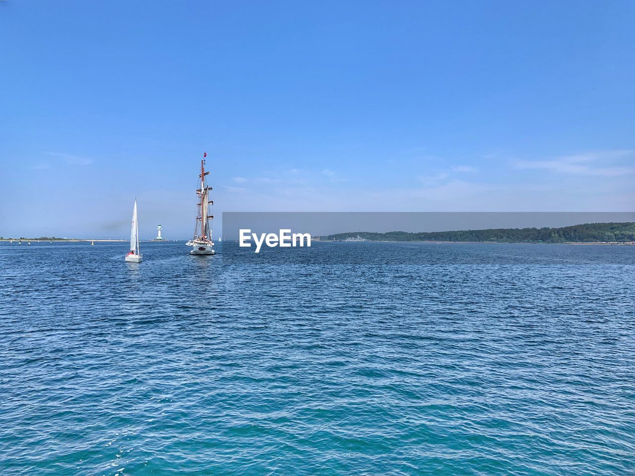 water, sea, blue, sky, waterfront, beauty in nature, transportation, day, scenics - nature, no people, nature, nautical vessel, industry, fuel and power generation, non-urban scene, oil industry, outdoors, offshore platform, mode of transportation, sailboat